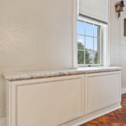 Custom built traditional white wood panel cabinets with white marble countertop, refaced kitchen cabinets in Philadelphia, PA by Lowe's National Refacing Systems.