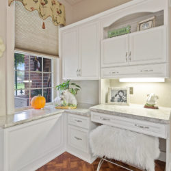 Traditional white kitchen cabinets with wall mounted office desk space and white marble countertops, refaced kitchen cabinets in Philadelphia, PA by Lowe's National Refacing Systems.