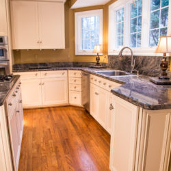 Off White Kitchen with Brushed Nickel Hardware and Full Height Back Splash