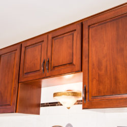 Bottom of Wall Cabinets Refaced with Dark Cherry Wood Veneer