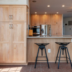 Nature Maple Kitchen with Pantry Cabinet and Tan Bar Overhang Countertop