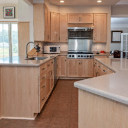 Nature Maple Kitchen with Shaker Style Crown Molding and Bullnose Tan Countertops