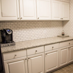 White Kitchen with MDF Center Raised Panel Doors and White Subway Tile Backsplash